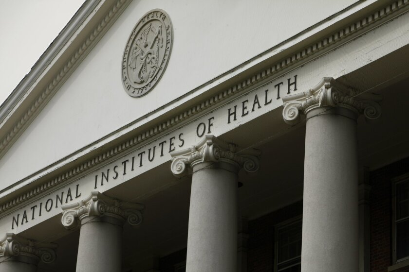 FILE - The main building of the National Institutes of Health is seen in Bethesda, Md., in this Aug. 17, 2009 file photo. Ten clinicians with a Boston-based nonprofit organization responding to the Ebola outbreak in Sierra Leone are to be transported to the United States after one of their colleagu