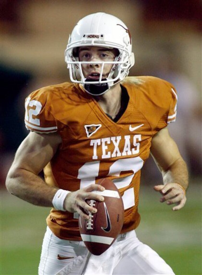 In this Nov. 27, 2008 file photo, Texas junior quarterback Colt McCoy rolls to his left and looks toward receiver during an NCAA college football game against Texas A&M, in Austin, Texas. McCoy was selected as The Associated Press' Big 12 offensive player of the year. (AP Photo/Harry Cabluck, File)