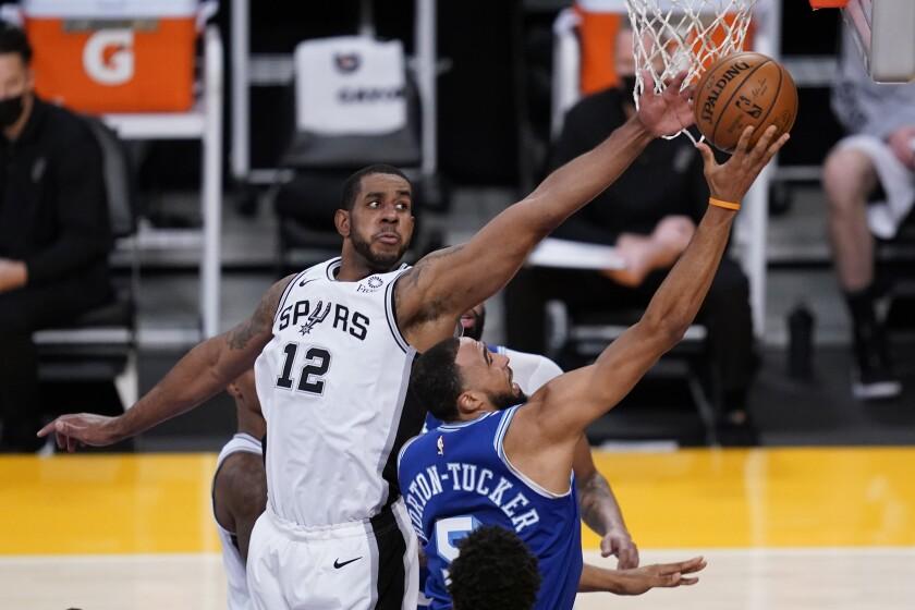 San Antonio Spurs forward LaMarcus Aldridge, left, defends against Los Angeles Lakers guard Talen Horton-Tucker during the second quarter of an NBA basketball game Thursday, Jan. 7, 2021, in Los Angeles. (AP Photo/Ashley Landis)