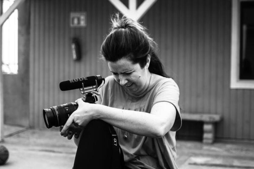 The documentarian with her camera