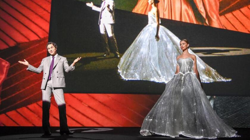 IMAGE DISTRIBUTED FOR ADOBE - Fashion designer Zac Posen takes the stage at Adobe MAX, The Creativity Conference, with his light-up, fiber optic dress on Thursday, Nov. 3 , 2016 in San Diego. The dress was originally designed for Claire Danes' 2016 Met Gala appearance. (Denis Poroy/AP Images for Adobe)