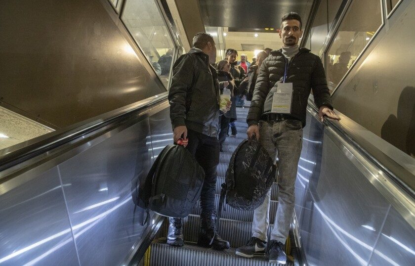 SEATTLE, WASH. -- WEDNESDAY, FEBRUARY 6, 2019: Iranian refugee Sirvan Moradi, 24, right, descends a
