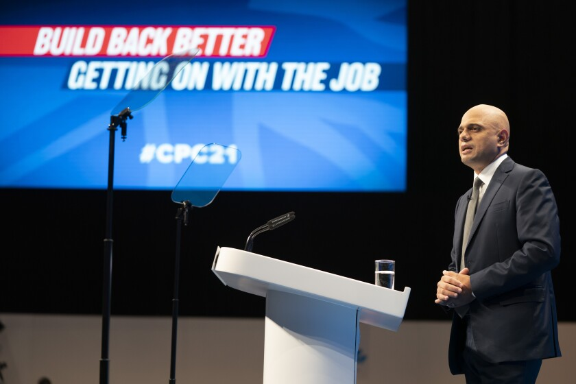 Sajid Javid, Secretary of State for Health and Social Care, speaks at the Conservative Party Conference in Manchester, England, Tuesday, Oct. 5, 2021. (AP Photo/Jon Super)