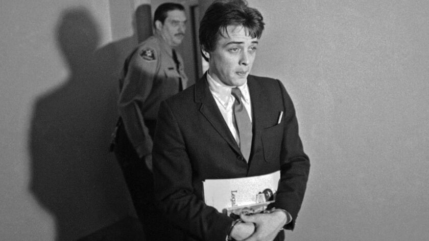 In this Jan. 21, 1970, file photo, Robert Beausoleil, then 21, leaves a courtroom in Los Angeles.
