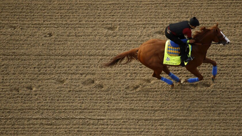 Kentucky Derby entrant Justify runs during a morning workout at Churchill Downs Wednesday, May 2, 20