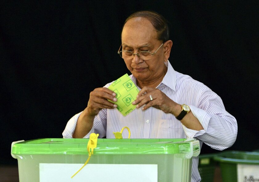 Myanmar's President Thein Sein casts his vote in Naypyitaw, Myanmar, Sunday, Nov. 8, 2015. Myanmar voted Sunday in historic elections that will test whether popular mandate can loosen the military's longstanding grip on power, even if opposition leader Aung San Suu Kyi's party secures a widely-expe