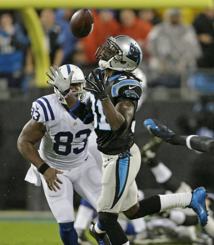 Carolina Panthers' Charles Tillman (31) intercepts a pass in front of Indianapolis Colts' Dwayne Allen (83) in the first half of an NFL football game in Charlotte, N.C., Monday, Nov. 2, 2015. (AP Photo/Bob Leverone)