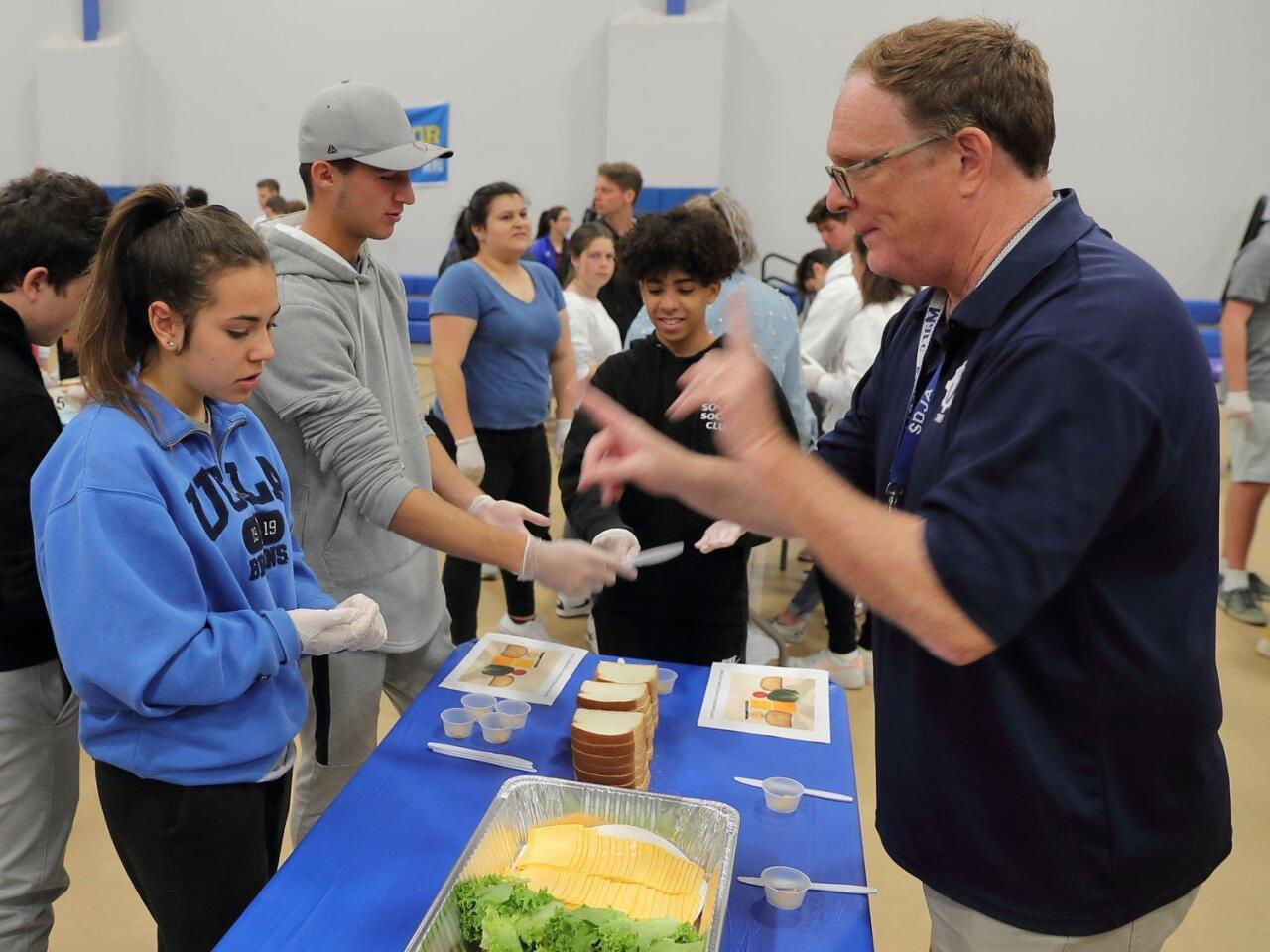 Students attempt to break sandwich-making record while feeding those in need