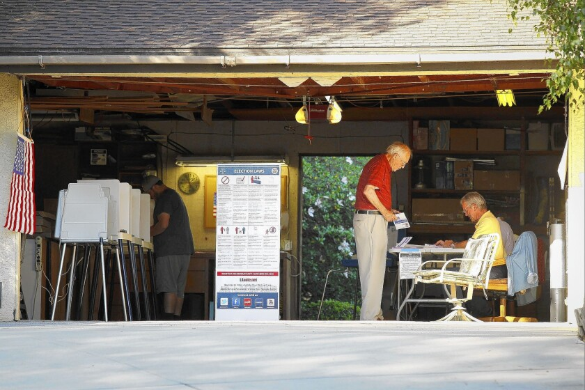 Voters cast their ballots for the California primary election at a polling place inside a garage near Covina. Republican candidates made surprisingly strong showings in several races.