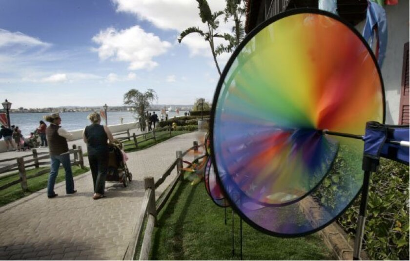 Visitors to the Seaport Village shopping complex on Harbor Drive strolled past some decorative wind spinners.
