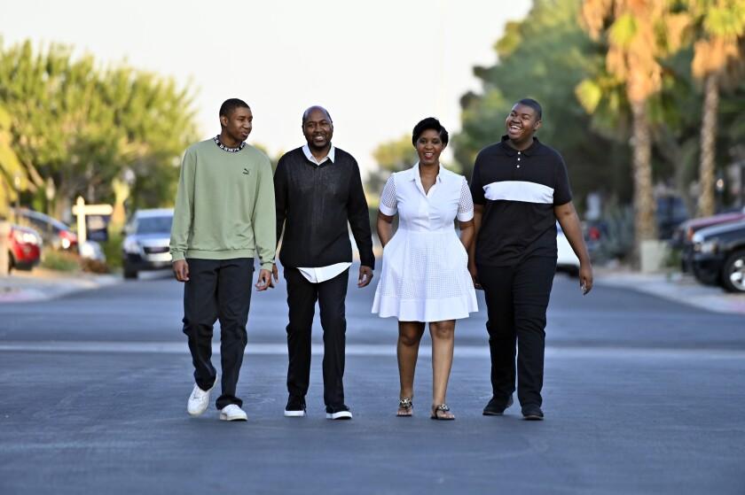 The Shelton family, who all voted for joe Biden and Kamala Harris, walk through their suburban Las Vegas neighborhood.