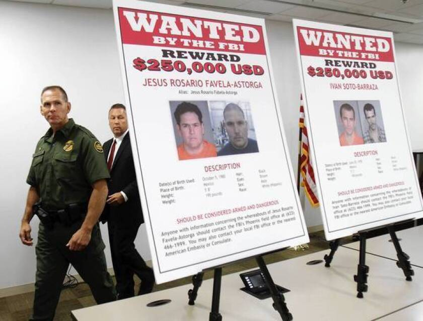 Federal agents unveiled posters of four men being sought in the December 2010 shooting of U.S. Border Patrol Agent Brian Terry.