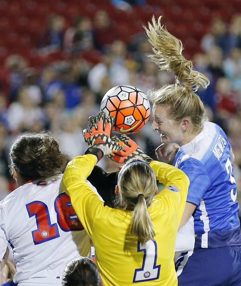 United States Midfielder Samantha Mewis (3) attempts to head the ball on a corner kick as Puerto Rico midfielder Nicole Esther Rodriguez (18) and goal keeper Karly Marie Gustafson (1) defend during the first half of a women's Olympic qualifying soccer match, Monday, Feb. 15, 2016 in Frisco, Texas.