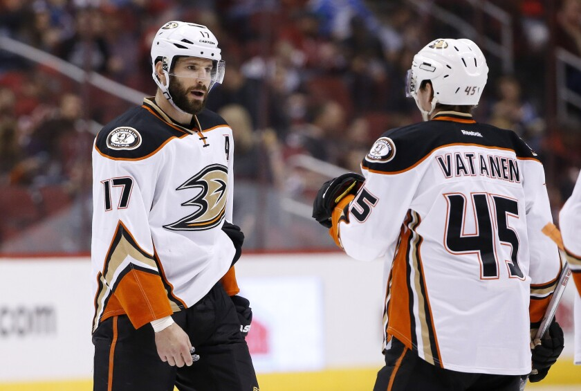 Ducks forward Ryan Kesler (17) talks with defenseman Sami Vatanen (45) during the second period of a game against the Arizona Coyotes on March 3.