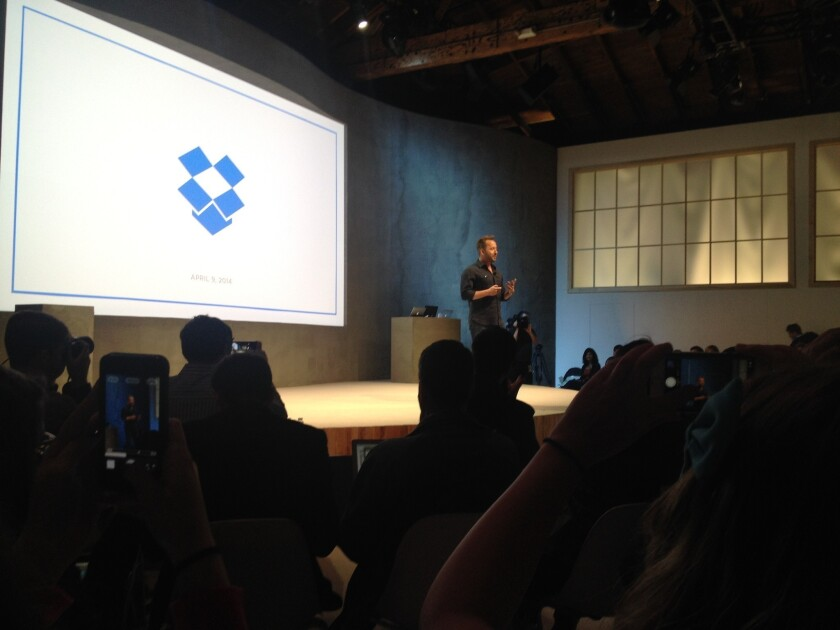Drew Houston, chief executive of Dropbox, announces new apps and a new direction for the company at a news conference Wednesday.