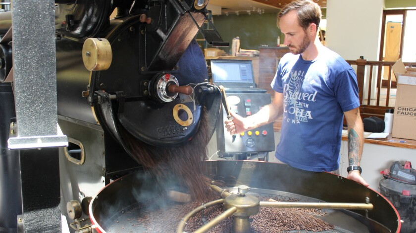 Master roaster Kyle Evans prepares a batch of beans. Customers can now get a first-hand glimpse of the action.