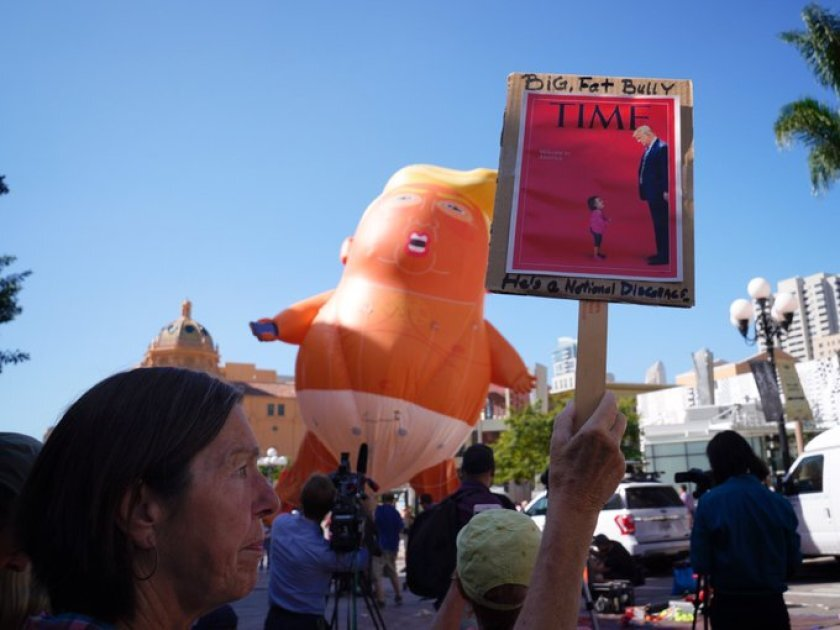 """Protesters inflate a """"baby Trump"""" balloon in downtown San Diego"""