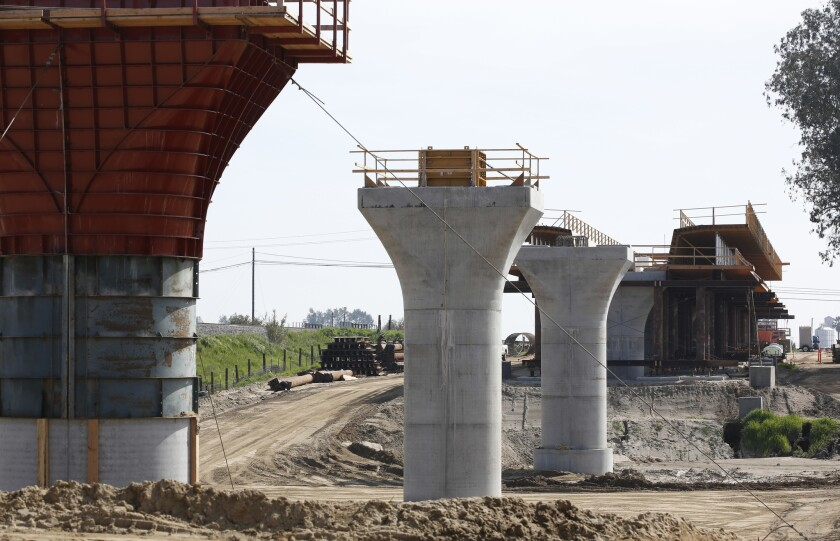 Supports for a 1,600-foot-viaduct to carry high-speed rail trains across the Fresno River are seen under construction near Madera, Calif. Voter signatures are being collected for a November ballot initiative that would shift what's left of the bullet bonds to water projects.