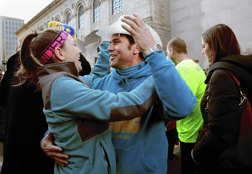 """Alexander """"Carlos"""" Arredondo, who aided victims of the Boston Marathon bombing last year, joins a reunion of survivors at the finish line on Boylston Street on April 6."""