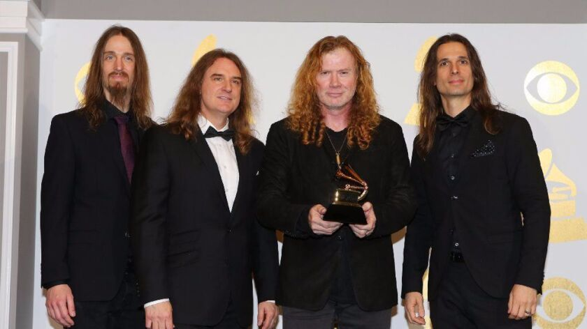 La Mesa native and Megadeth leader Dave Mustaine holds his band's first Grammy Award.