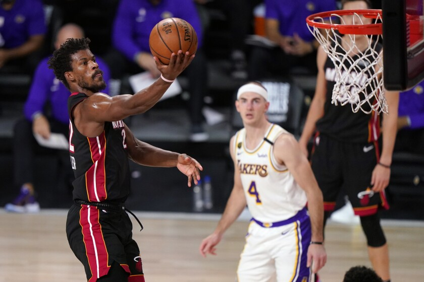 Miami Heat's Jimmy Butler (22) goes up for a basket during the second half in Game 6 of basketball's NBA Finals against the Los Angeles Lakers Sunday, Oct. 11, 2020, in Lake Buena Vista, Fla. (AP Photo/Mark J. Terrill)
