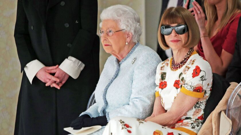Queen Elizabeth II, left, and Anna Wintour at the Richard Quinn fashion show.