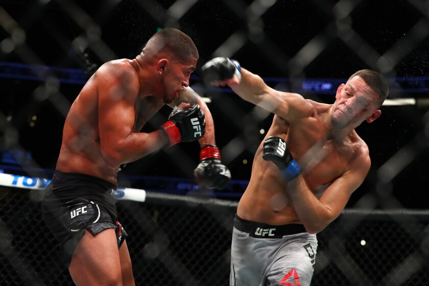Nate Diaz throws a punch at Anthony Pettis in the second round during their Welterweight Bout at UFC 241 at Honda Center on Saturday.