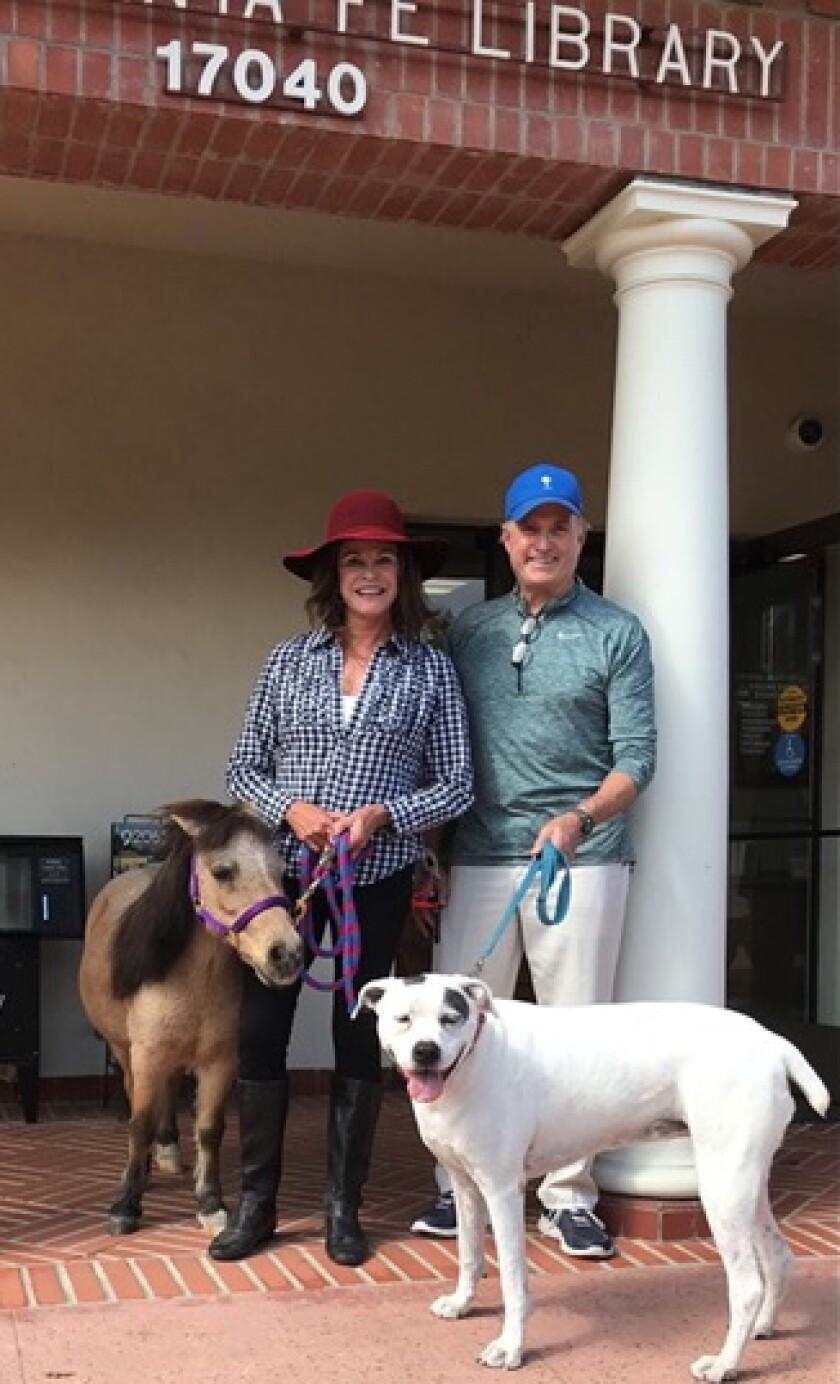 Stacy, John, Sugar and Charger Snyder at the Rancho Santa Fe Library