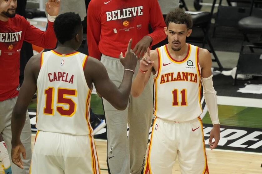 Atlanta Hawks' Trae Young and Clint Capela celebrate.