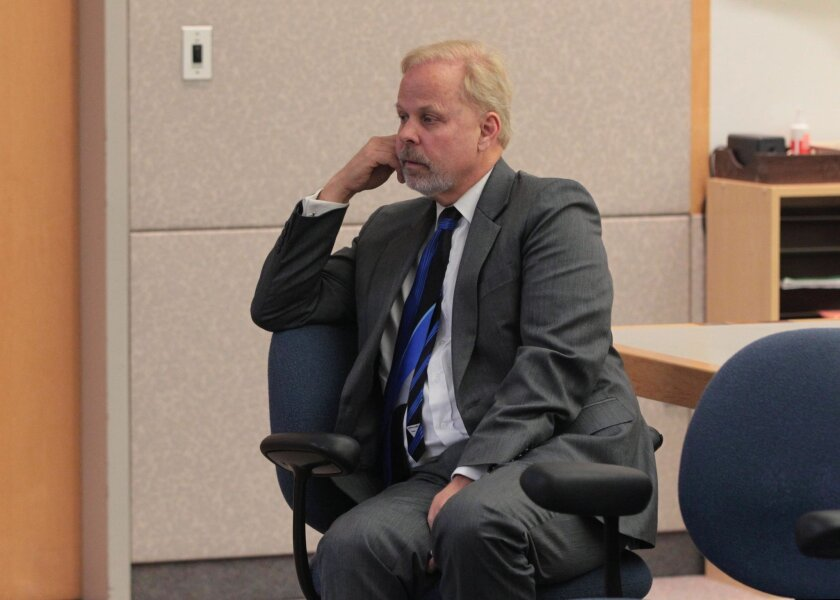 Robert O. Young sits in the courtroom alone at the Vista Courthouse after hearing the jury in his case was deadlocked in 6 of the 9 charges against him. He was found guilty of 2 and not guilty of 1. The jury deliberated for 10 days.