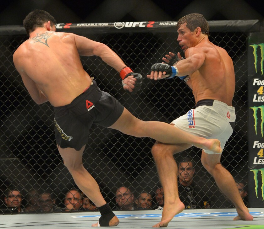 Dominick Cruz strikes with his right leg during the bantamweight title fight against Urijah Faber at UFC 199.