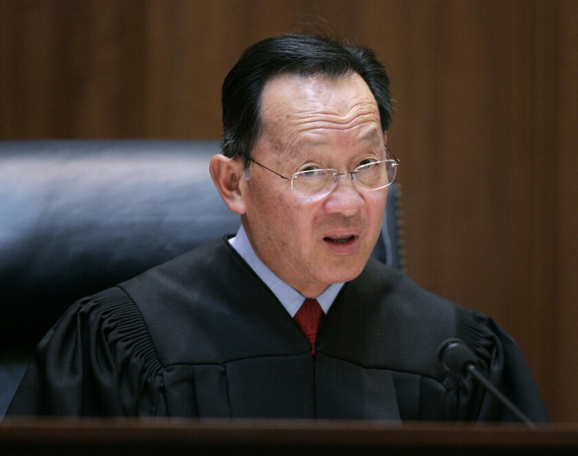 FILE - In this March 4, 2008 file photo, California Supreme Court Associate Justice Ming W. Chin speaks from the bench in San Francisco, Ming, a legal trailblazer and the first Chinese American appointed to California's Supreme Court, said Wednesday, Jan. 15, 2020, that he will retire this year. (AP Photo/Paul Sakuma, Pool)