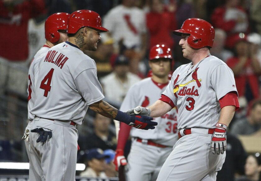 St. Louis Cardinals' Jedd Gyorko is congratulated by Yadier Molina after hitting a three-run home run against the San Diego Padres during the eighth inning of a baseball game Saturday, April 23, 2016, in San Diego. (AP Photo/Lenny Ignelzi)