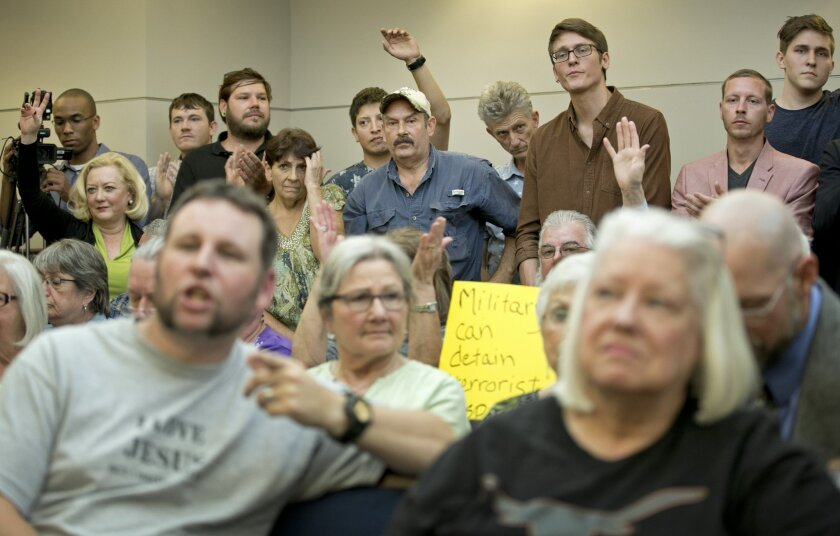 People listen at a public hearing about the Jade Helm 15 military training exercise in Bastrop, Texas, on April 27.