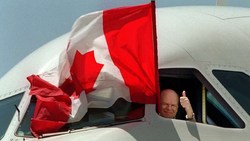 Air Canada Capt. Jacques Boucher gives thumbs up.