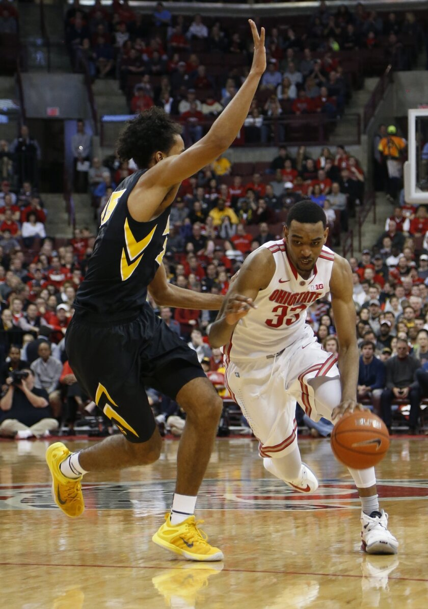 Ohio State's Keita Bates-Diop, right, drives to the basket against Iowa's Dom Uhl during the second half of an NCAA college basketball game Sunday, Feb. 28, 2016, in Columbus, Ohio. Ohio State beat Iowa 68-64. (AP Photo/Jay LaPrete)