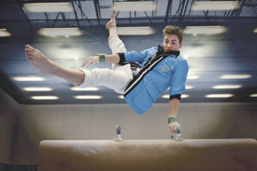 Gymnast Philipp Boy models the reversible jacket Bogner designed for the German team to wear at the 2012 Games. The nylon shell converts into a baby blue blazer.