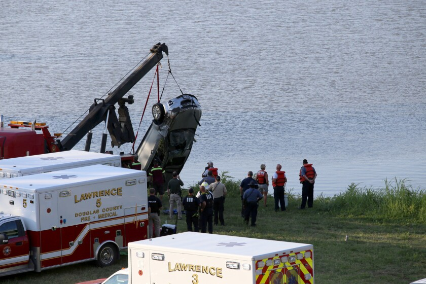 A vehicle is pulled out of the Kansas River on Friday.