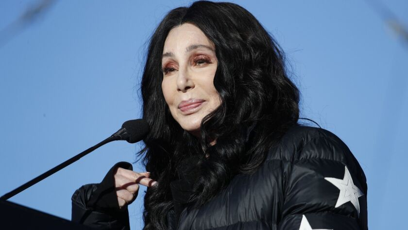 FILE - In this Jan. 21, 2018 file photo, Cher speaks during a women's march rally in Las Vegas. Auth