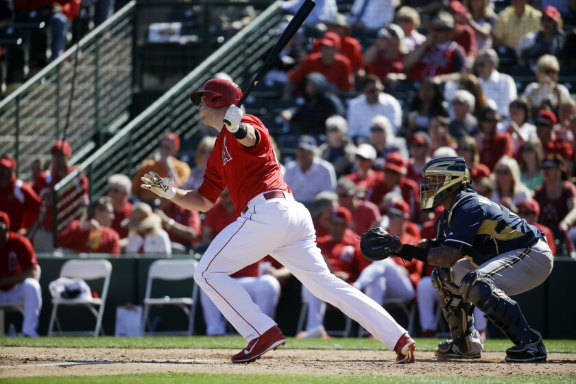 Angels first baseman C.J. Cron hits a double in a spring training game against the Brewers.