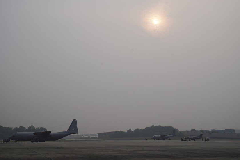 A military plane is parked before a cloud seeding mission at Subang military airbase as sky is shrouded with haze in Subang, Malaysia, Thursday, Sept. 19, 2019. Indonesian forest fires spread health-damaging haze across the country and into neighboring Malaysia and Singapore. Malaysian authorities used cloud seeding Monday in an attempt to clear the thick haze engulfing the nation's capital. (AP Photo/Vincent Thian)
