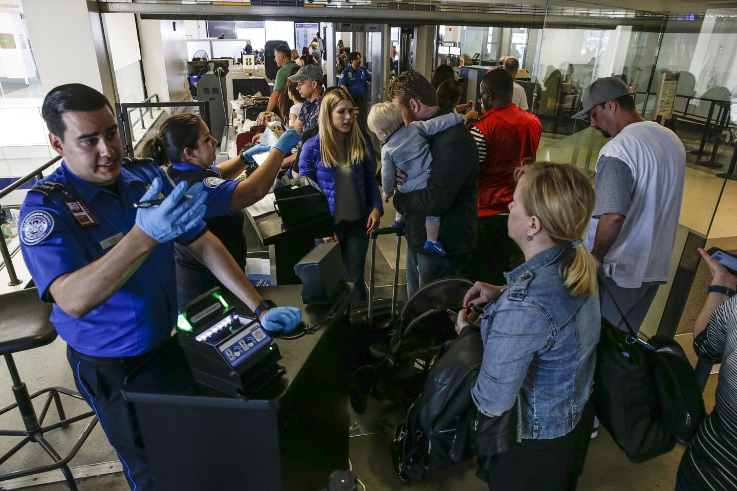 Memorial Day weekend travelers line up at a TSA checkpoint at the United Airlines Terminal at LAX.
