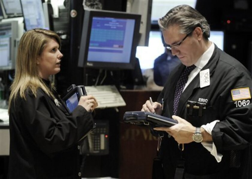 A pair of traders work on the floor of the New York Stock Exchange, Wednesday, Dec. 10, 2008. Wall Street tussled with fresh worries about the health of financial sector and the Big Three automakers Wednesday, forcing stocks to surrender most of their early gains. (AP Photo/Richard Drew)