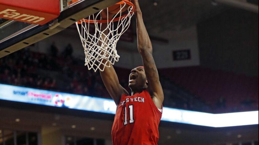 Texas Tech's Tariq Owens (11) dunks the ball during the second half of an NCAA college basketball ga