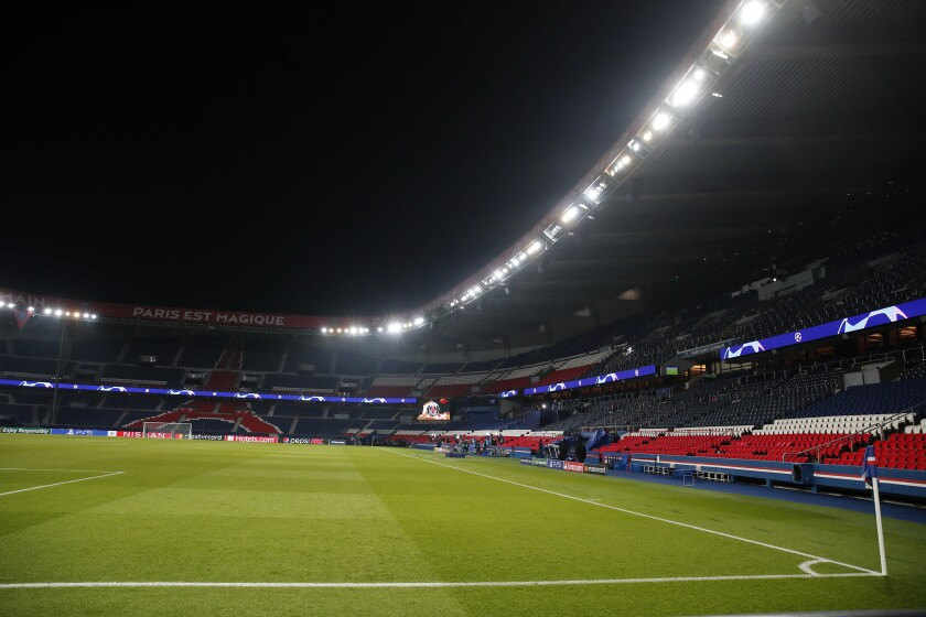 The empty pitch Parc des Princes stadium during the Champions League group H soccer match between Paris Saint Germain and Istanbul Basaksehir, in Paris, Tuesday Dec. 8 , 2020. PSG and Basaksehir teams walk off field in protest of alleged racist slur by 4th official during Champions League game (AP Photo/Francois Mori)