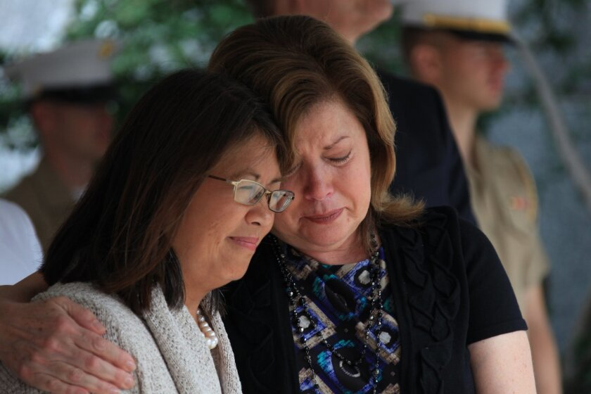 Karen Kelly, pictured in June 26, 2011, embraces a friend during the closing ceremony of Marine Week St. Louis, which paid tribute to Gold Star families who lost a relative killed in combat.