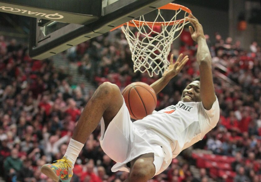 Utah State Aggies at SDSU Aztecs basketball- SDSU's Dakarai Allen slam dunks for two points in the first half.