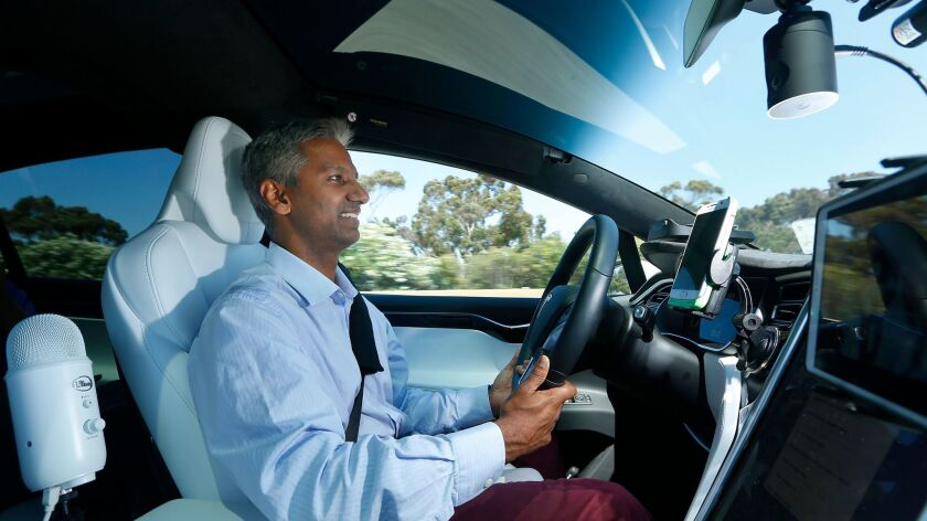 Tesloop co-founder and CEO Rahul Sonnad drives one of his company's cars around the San Diego area.