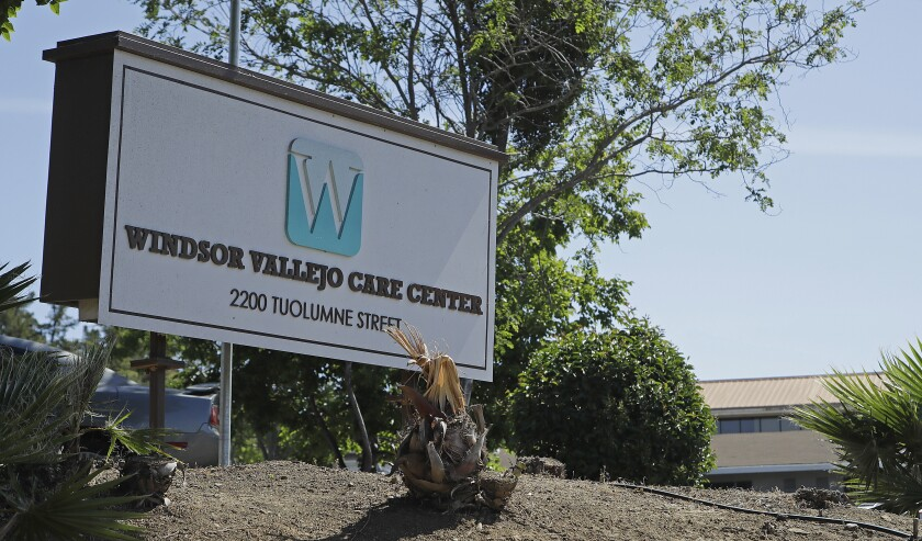 Windsor Vallejo Care Center's business sign at the center's entrance.