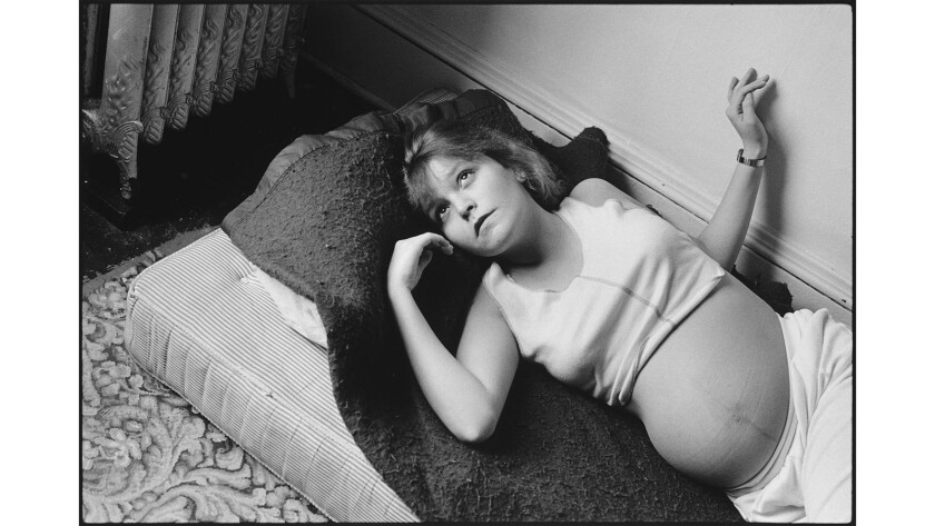 """For more than 30 years, photographer Mary Ellen Mark, who passed away in May, chronicled the life of Erin """"Tiny"""" Blackwell, from her troubled teen years to an adulthood filled with struggle. Seen here: The teenage Tiny in 1985, pregnant with her first son, Daylon."""